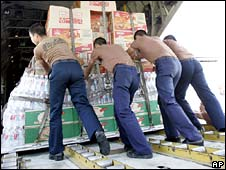 Thai soldiers load supplies for cyclone victims onto a Thai military transport plane in Bangkok