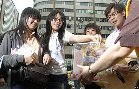 Charity workers raise funds towards the quake relief operation in Taipei, Taiwan, on Thursday