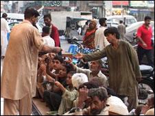 Poor people queuing
