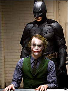 Christian Bale, as Batman and Heath Ledger as the Joker