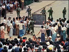 Burmese soldiers face protesters in Rangoon on 26 August 1988