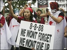 Burmese activists shout a slogan in front of China Embassy in Bangkok on Friday