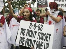 Burmese activists shout a slogan in front of China Embassy in Bangkok on Friday