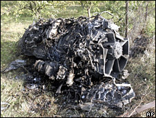 A photo showing what Georgian authorities say is the debris of a Russian bomber that they allege was shot down near the village of Dzevera on Saturday (10 August 2008)
