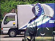 An illustration of a person wearing an invisibility cloak