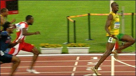 Usain Bolt jogs over the line