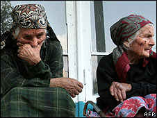 Elderly refugees from South Ossetia sit in a refugee camp in North Ossetia, Russia,  on 10 August