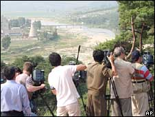 Foreign camera crews prepare to film the demolition of the cooling tower at the Yongbyon nuclear plant in North Korea on 27 June