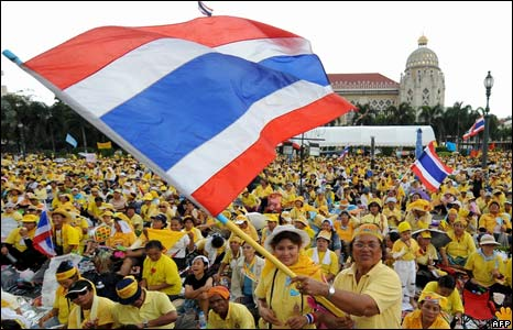 Anti-government protesters wave Thai national flags during a protest inside Government House in Bangkok on 27 August, 2008