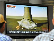 South Koreans watch a cooling tower blowing up, file image