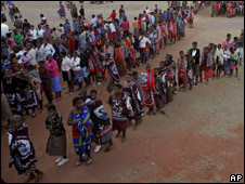 "Women who took part in the birthday celebrations for Swaziland""s King Mswati III stand in line for food"