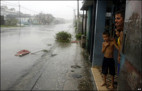 Residents shelter from heavy rain in Camaguey, Cuba's third-largest city, on 8 September 2008