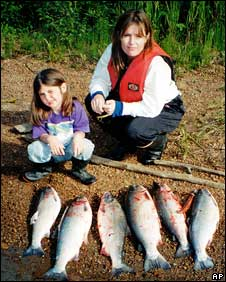Sarah Palin with one of her daughters on a fishing trip (handout)