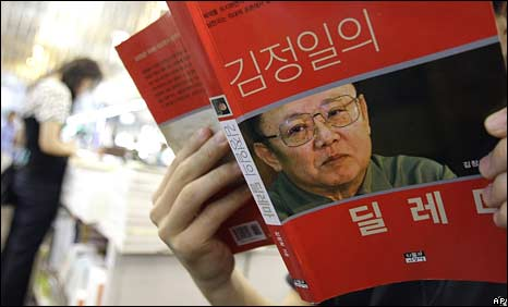 A South Korean man studies a book by North Korean leader Kim Jong-il in a bookshop in Seoul on Wednesday