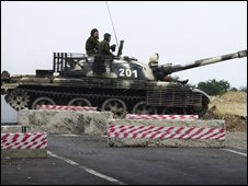 A Russian tank crosses a main route in Georgia