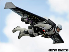 Yves Rossy flies across the English Channel using a personal jet pack.