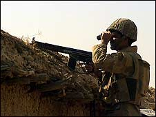 A soldier keeps watch