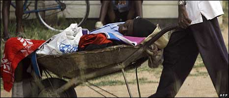 A man pushes his relative with cholera in a wheelbarrow in Zimbabwe