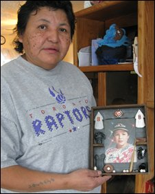 Valerie holds a picture of her nephew who died of cancer