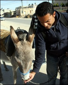 Aleem Maqbool with donkey