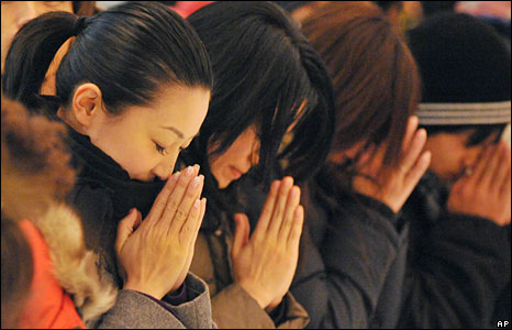 In Japan, many went to Tokyos Zojoji Buddhist temple to offer a prayer at the end of the year. -- Courtesy of the BBC and AP