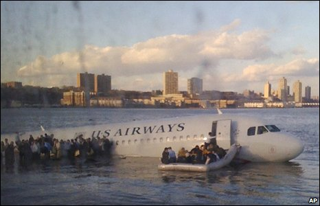 In this photo taken by a passenger on a ferry, airline passengers exit the ditched aircraft
