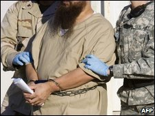 A detainee being escorted at Guantanamo Bay prison camp