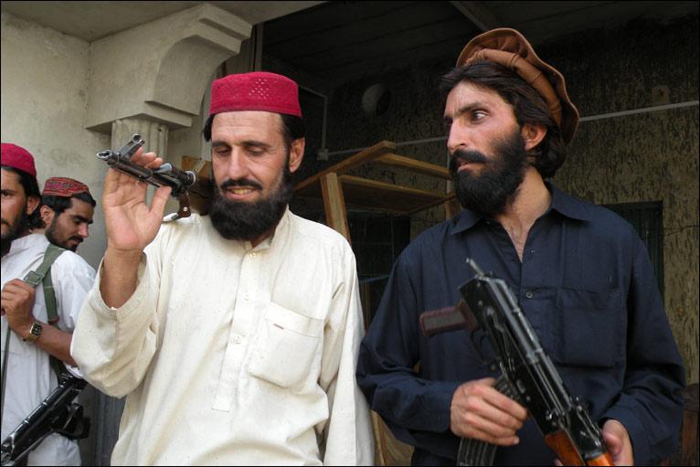 Haji Turkistan Bhittani (left, wearing a red skullcap)