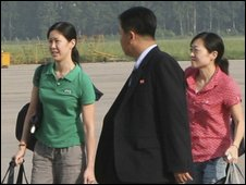 Laura Ling (R) and Euna Lee (R) at Pyongyang airport - 5 August 2009