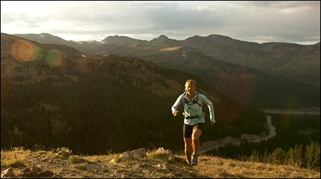 Diane Van Deren running on a mountain