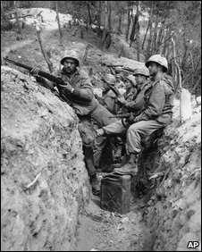 US soldiers in front-line trench during Korean War. With rifle, left, PFC. Richard Pantoliano of Brooklyn, N.Y., and right, foreground, with carbine is PFC. Robert Curtis of Torrance, Calif. Other soldiers, background, are unidentified - 1 May 1951