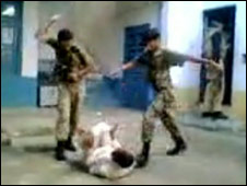 Men in Pakistani army uniform are seen beating a suspect