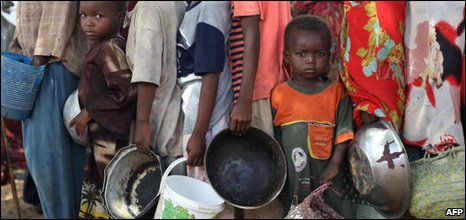 Somali people queue at a World Food Program camp in Mogadishu, file image
