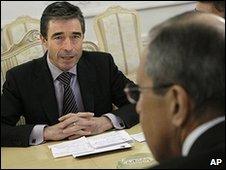 Anders Fogh Rasmussen (left) talks to Sergei Lavrov