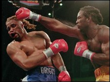 Lennox Lewis and Shannon Briggs in the ring during their title fight in Atlantic city, 1998
