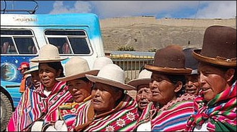 Bolivian women outside Centro Lola, Choritotora, Bolivia