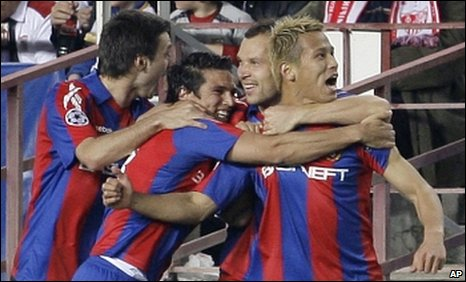 Keisuke Honda (right) celebrates scoring for CSKA