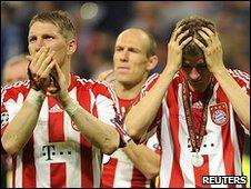 Bayern's Bastian Schweinsteiger and Thomas Muller show their dismay