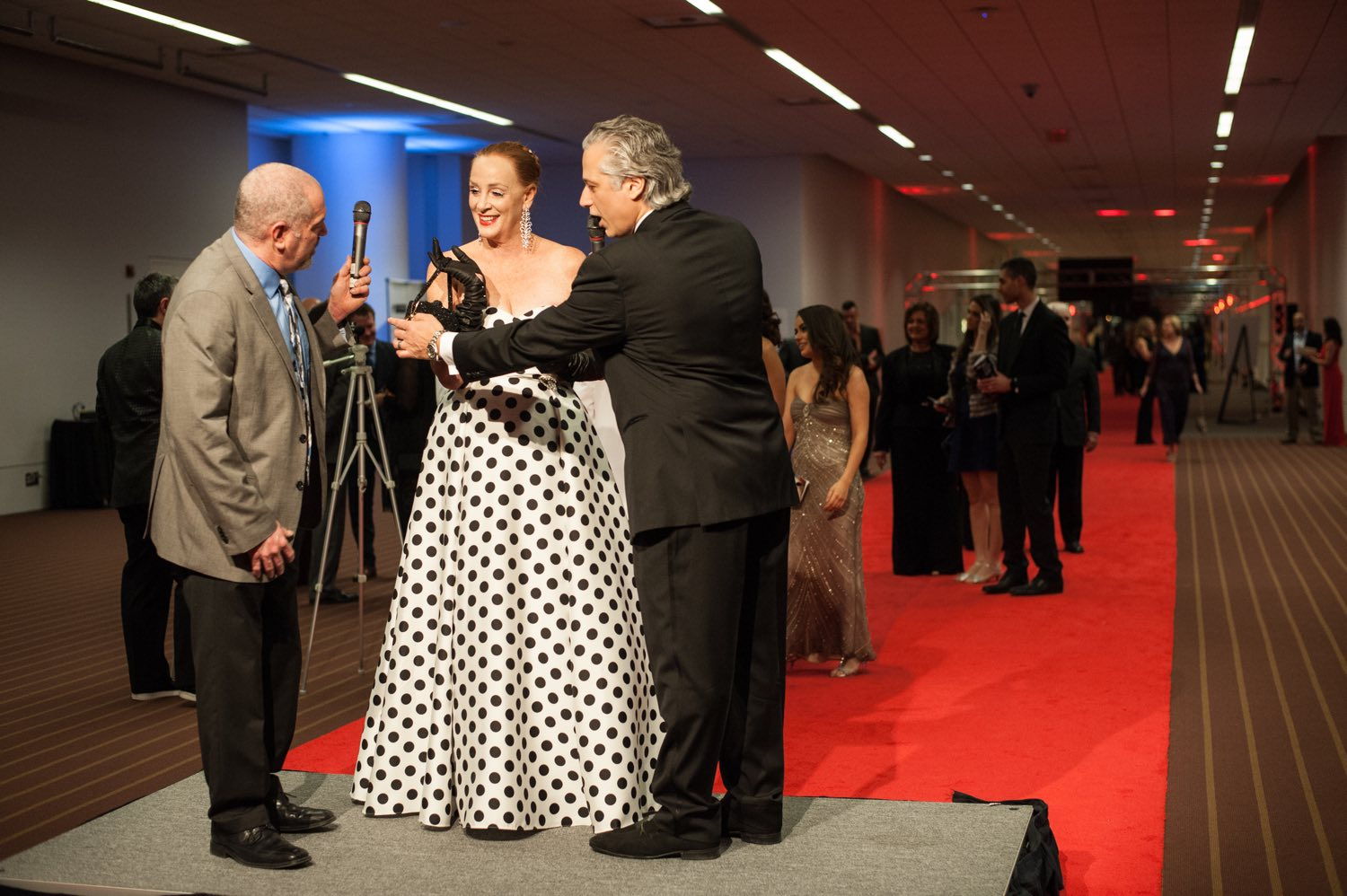 """100.7 Star's Bubba interviews Anne Stone on the red carpet with the help of Emilio Cornacchione at the Pittsburgh Film Office's """"Lights! Glamour! Action"""" Oscars party on Sunday, Feb. 26, 2017 at the David L. Lawrence Convention Center in downtown Pittsburgh. (Stephanie Strasburg/Pittsburgh Post-Gazette)"""
