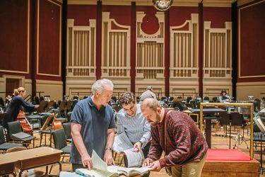 From left, Manfred Honeck, Associate Conductor Andres Franco, Countertenor Andrey Nemzer compare notes after Pittsburgh Symphony practice at Heinz Hall. (Andrew Rush/Post-Gazette)