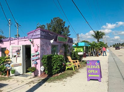 A road runs through it. Tiny colorful shops - the shells of old fishermen's shacks line two lane road leading through Matlacha, Florida. (Patricia Sheridan/Post-Gazette)