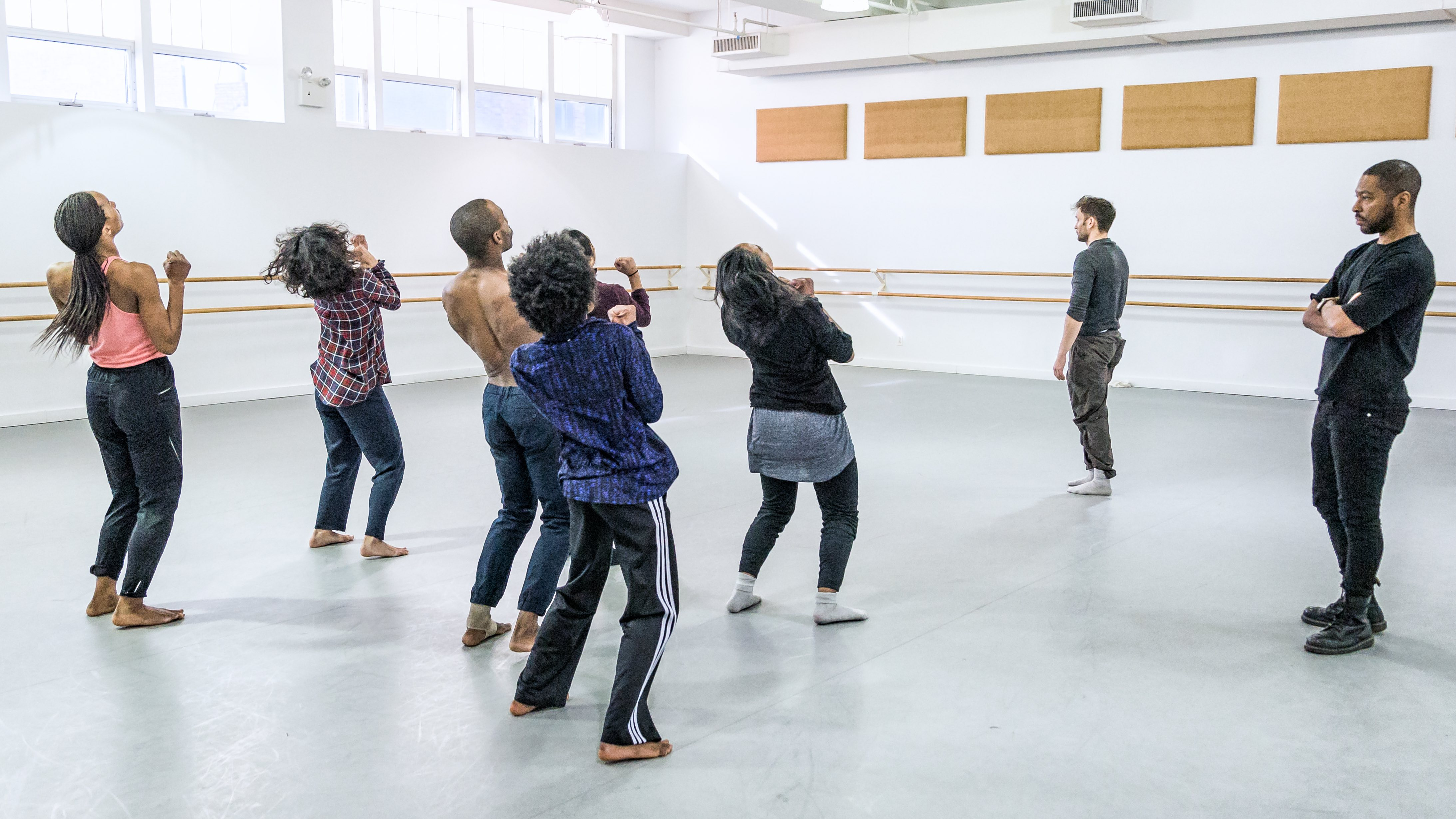 Kyle Abraham, far right, watches his company Abraham.In.Motion during a rehearsal. (Photo by Tim Barden)