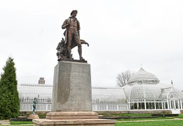 A view of a statute of Scottish poet Robert Burns by sculptor John Massey Rhind outside Phipps Conservatory in Oakland. (Nate Guidry/Post-Gazette)