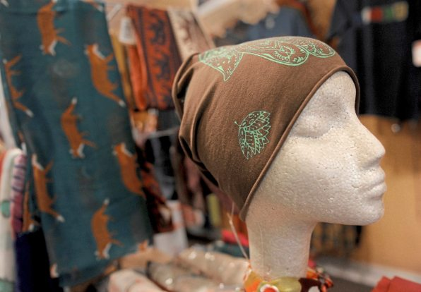 Water Pashmina skull caps, scarves and shawls at Snow Lion Imports on South Craig Street in Oakland. (Pam Panchak/Post-Gazette)