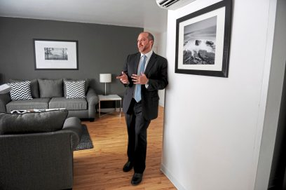 Jonathan Plesset talks about the new dog-friendly design and amenities in one of the suites at the Shadyside Inn All Suites Hotel on Fifth Avenue. (Pam Panchak/Post-Gazette)