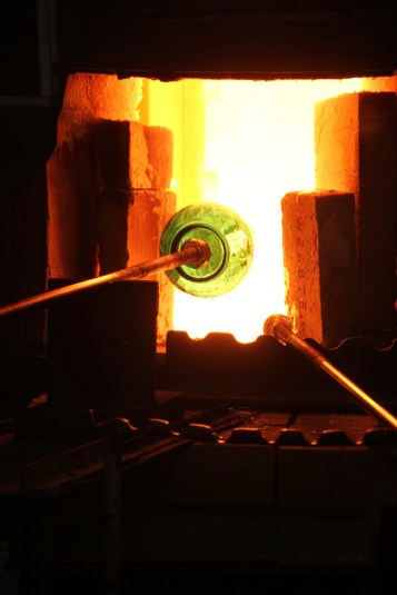 A glass vase is shaped by fire at Blenko Glass. (Patricia Sheridan/Post-Gazette)