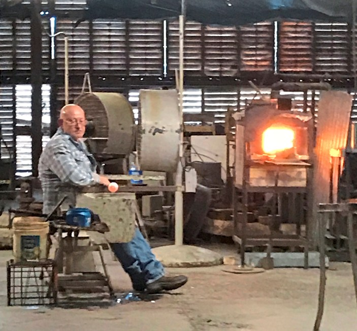 Rolling a new piece just out of the furnace at Blenko Glass. (Patricia Sheridan/Post-Gazette)