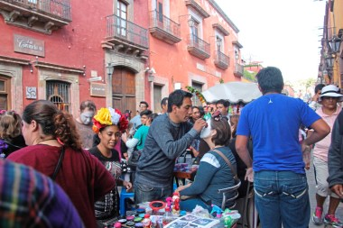 Face painting in the streets for the Day of the Dead in San Miguel de Allende, Mexico. credit Patricia Sheridan
