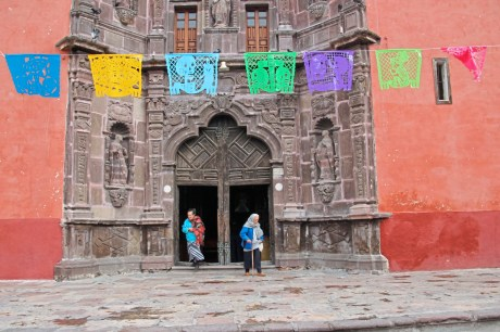 Distinction Strings of papel picado hang in the square in front of the church of Our Lady of Health in Mexico's San Miguel de Allende. credit Patricia Sheridan