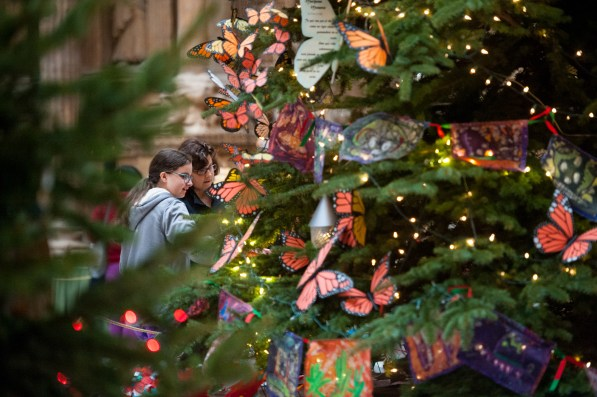 Ava Gagne, left, of Sewickley, and her mother, Jane, admire the Christmas trees at the Carnegie Museum of Art in Oakland on Christmas Eve in 2016. (Stephanie Strasburg/Post-Gazette)
